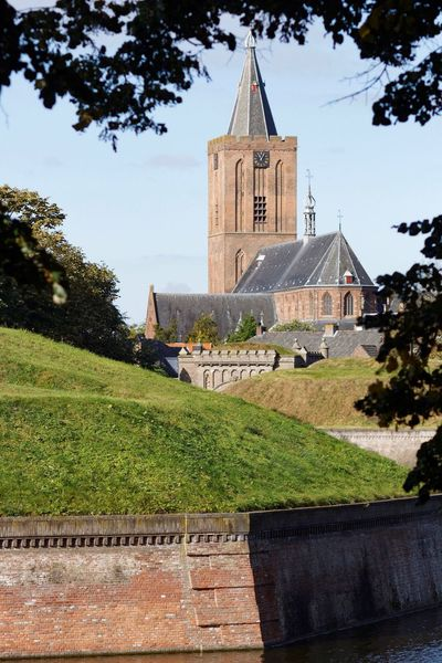 Naardenvesting Naarden Church Architecture Built Structure Building Exterior Tree Religion Place Of Worship Tower Branch Growth Lawn Day In Front Of Exterior Green Color Outdoors Tall - High No People Footpath Green