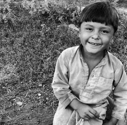 Shallow grins Portrait Childhood Happiness Open Edit Eyem Shooting Without Bullets Streetphotography Village Life Pakistan EyeEm Exploring Rural Life Streetsofpakistan Street Photography Outdoor Photography OpenEdit Village Outdoors Monochromatic