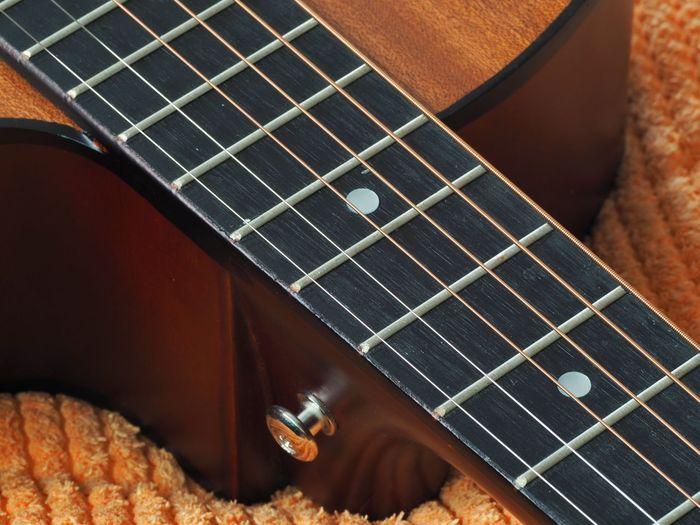Close-up of guitar playing piano