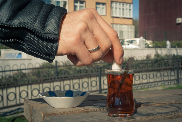 Adult Architecture Building Exterior Close-up Day Drink Focus On Foreground Food And Drink Freshness Herbal Tea Holding Human Human Body Part Human Hand Lifestyles Mint Tea One Person Outdoors People Real People Refreshment Table Tea - Hot Drink Women çay