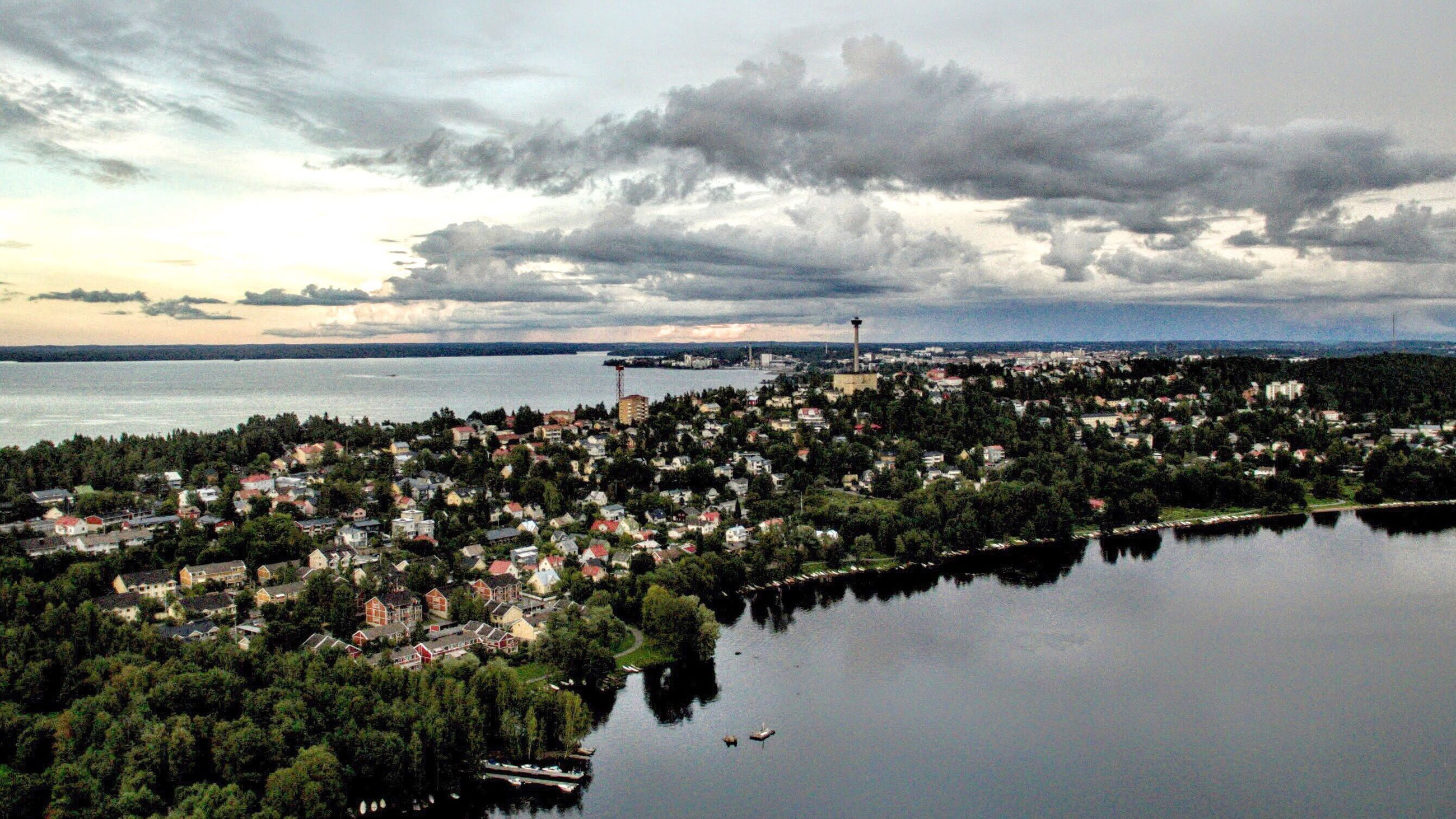 water, sky, built structure, architecture, sea, tree, building exterior, cloud - sky, river, cloud, waterfront, nature, horizon over water, flower, cloudy, growth, plant, city, day, high angle view