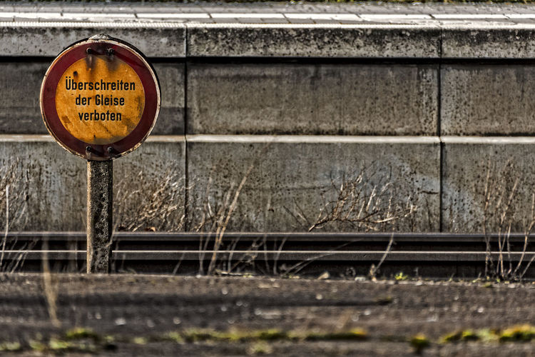 sign Communication Day Metal No People Outdoors Rail Rail Transport Road Sign Splints Text Track Train Station