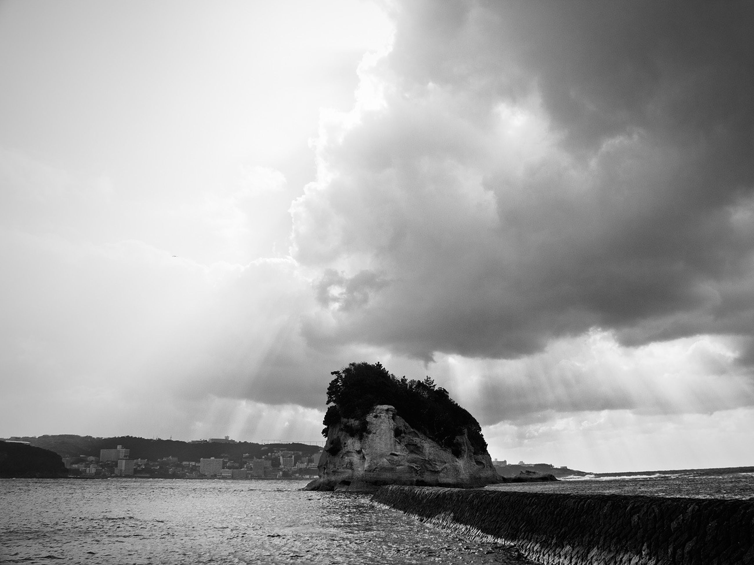 sky, water, cloud - sky, sea, cloudy, scenics, beauty in nature, tranquil scene, tranquility, nature, rock - object, waterfront, overcast, cloud, weather, power in nature, rock formation, beach, horizon over water, day
