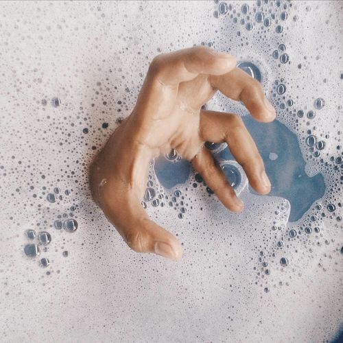 Close-Up Of Hand In Bathtub