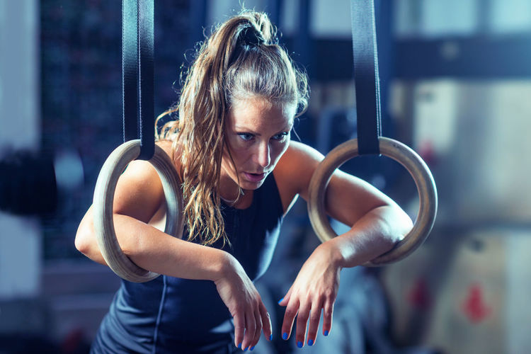 Woman Athlete Exercising on Gymnastic Rings Training Gymnastic Rings Healthy Fitness Gym Exercise Body & Fitness Health Woman Fit Athlete Workout Muscular Young Female Sport Lifestyle Muscle Strength People Athletic Bodybuilding Adult Endurance Cross
