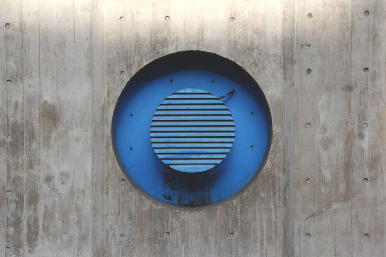Blue Circular Metal On Wooden Wall