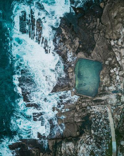 Aerial view on waterfall on rocks