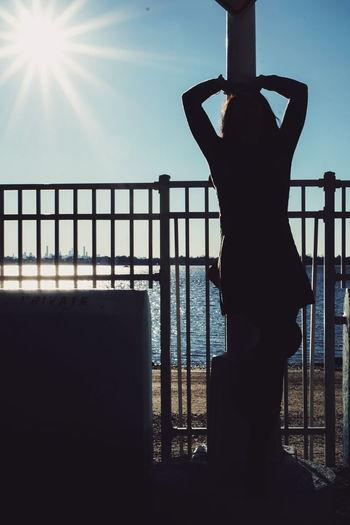 Girl One Young Woman Only Sky Outdoor Sunshine NYC New York Beauty Beautiful Woman Sexygirl Shadow Shadows & Lights Sun Sunbeam Sunrays Rays Light Luminosity Dress Pole Blue Sky Sea Water Silhouette Sunlight Railing City Beach The Portraitist - 2019 EyeEm Awards