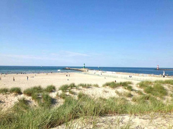 Beach Sea Baltic Sea Warnemünde Horizon Over Water Sand Water Sunny View Of The Sea Travel Destinations Tourism Sky Day Grass Lighthouse Tranquil Scene Tranquility Summer Outdoors Scenics Beauty In Nature Nature Incidental People Vacations Blue Sea