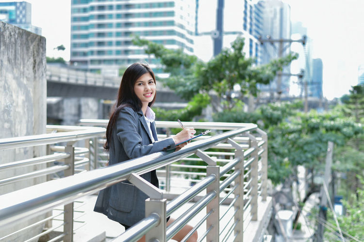 Business District Committed  Communicate Organization ASIA Asian  Background Beautiful Beauty Building Business Business Woman Casual Cheerful City Communications Computer Confident  Document Female File Happiness Happy International Internet Interview Japan Japanese  Job Lady Leader Leadership Manager Note Occupation Office Online Business Outdoor People person Professional Smile Test Thai Traffic Woman Work Worker Writing Young Adult