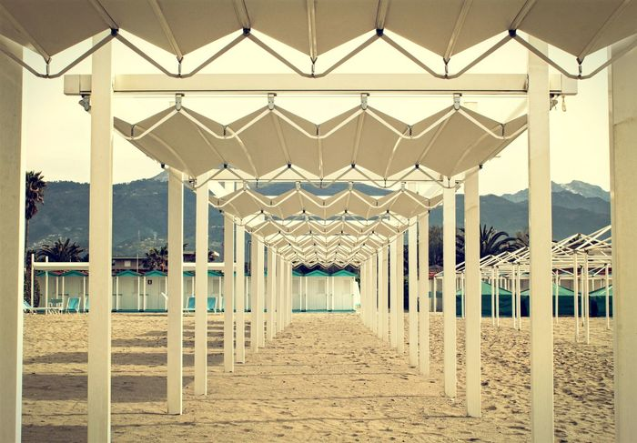 Beach tents in Italy Beach Beach Photography Beach Tent Beachphotography Diminishing Perspective Geometric Shapes Geometry Italy Landscape Landscape_Collection Prospective Sand