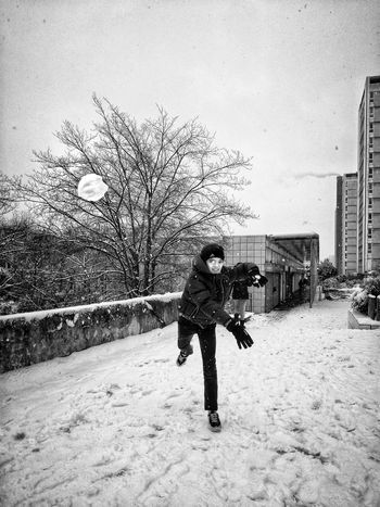 Snow battle. Young Adult Cityscape Photophone  Fotomobile Mobilephotography Snow Snow Ball Fight Snow Games Young Man Blackandwhite