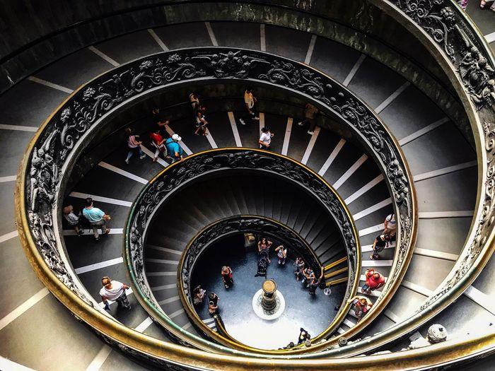 High Angle View Large Group Of People Steps And Staircases Staircase Steps Railing Architecture Real People Built Structure Stairs Women Day Men Indoors  Lifestyles Sitting People Adults Only Adult