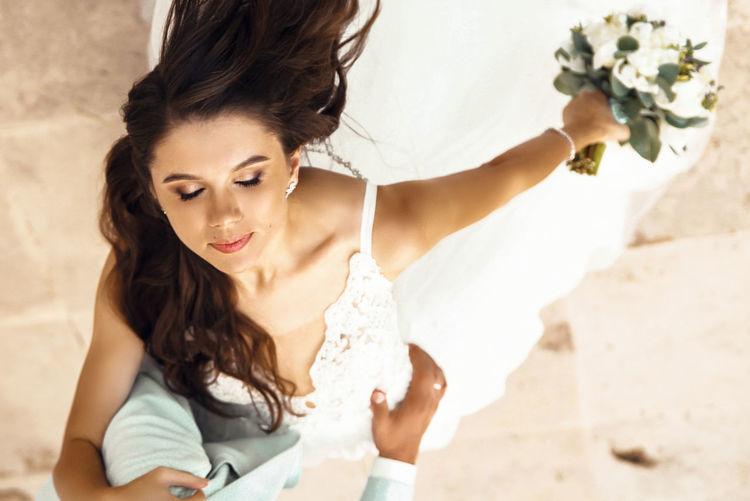 Portrait of beautiful woman holding white flower