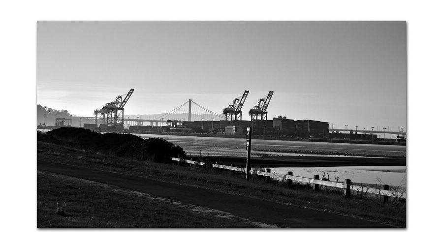 Shoreline Park At Middle Harbor 1 Estuary Low Tide Middle Harbor Port Of Oakland, Ca New Tower Eastern Span Bay Bridge Mudflats Gantry Cranes Maritime Port Containers Waterfront Late Afternoon Silhouettes Monochrome_Photography Monochrome Black & White Black And White Photography Black And White Black And White Collection  Landscape_Collection Landscape_photography Walkway Fence Low Schrubs