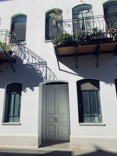 Sunny Built Structure Building Exterior Architecture Window Building Residential District Day No People Plant Balcony House Outdoors Sunlight Door Potted Plant Entrance