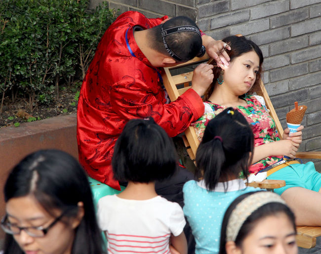 Bonding Carrying Casual Clothing Childhood China Chinese Culture Chinese Girl Cleaning Cleaning Ear Day Dramatic Angles Ear Ear Cleaner Ear Cleaning Family Family With One Child Leisure Activity Lifestyles Long Hair Love Mature Adult Person Pretty Girl Togetherness Young Women