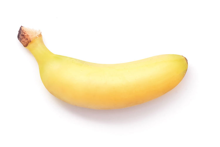 High angle view of yellow fruit against white background