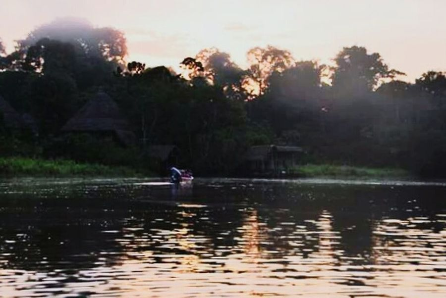 Sunset canoe ride Canoe Canoeing Jungle Amazon Lagoon