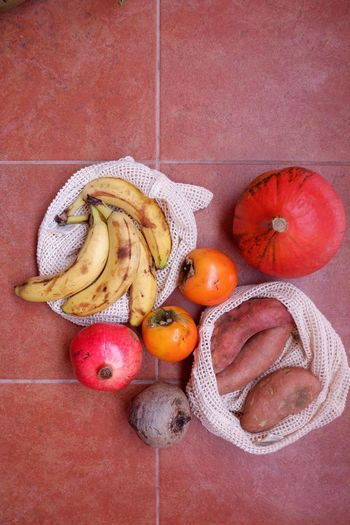 Directly above view of fruits and vegetables on tiled floor