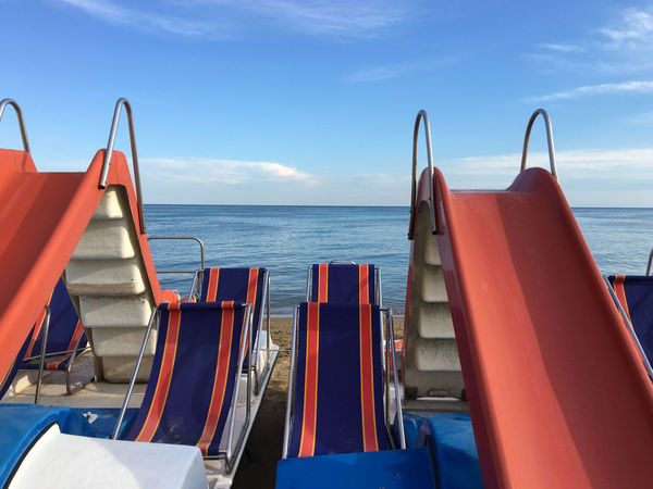 Pedal boat (Pedal) with slides and deck chairs, in calm blue sea background with white clouds on the horizon Pedal Boat Travel Boat Pedal Boat Relax Sea Summer Tourism