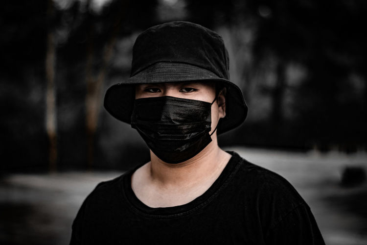 Portrait of man wearing face mask and cap