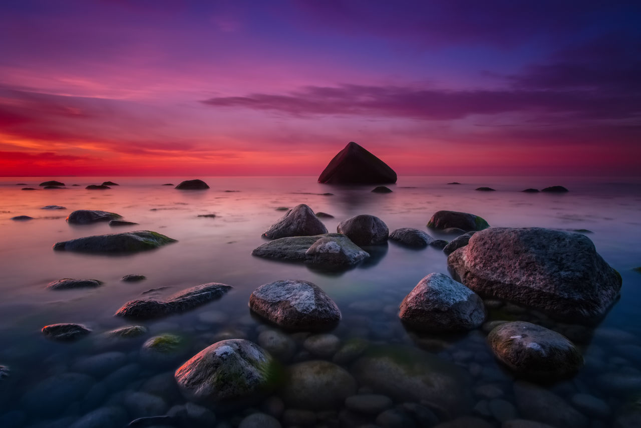 sunset, rock, solid, sky, beauty in nature, rock - object, sea, scenics - nature, tranquility, tranquil scene, cloud - sky, water, orange color, no people, nature, horizon over water, beach, land, idyllic, pebble, romantic sky