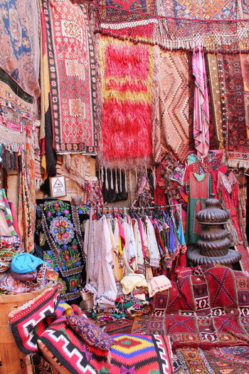 Colorful Carpet Art And Craft Business Carpet - Decor Choice Clothing Day Floral Pattern For Sale Hanging Large Group Of Objects Market Market Stall Multi Colored No People Outdoors Pattern Retail  Retail Display Sale Small Business Street Market Textile Textile Industry Variation