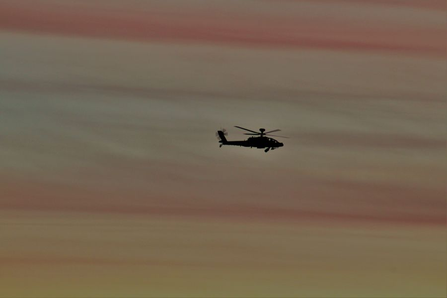 Air Vehicle Apache Apache Helicopter Canon Cloud - Sky Dramatic Skies Dramatic Sky Fast Flying Helicopter Journey Low Angle View Mid-air Military Military Life Mode Of Transport Motion On The Move Outdoors Silhouette Sky Speed Sunset Transportation Travel