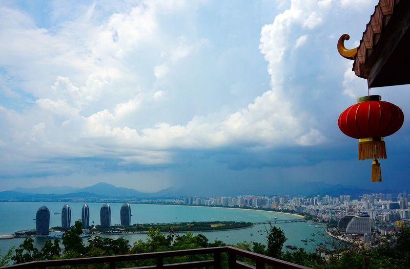 Panoramic shot of buildings by sea against sky