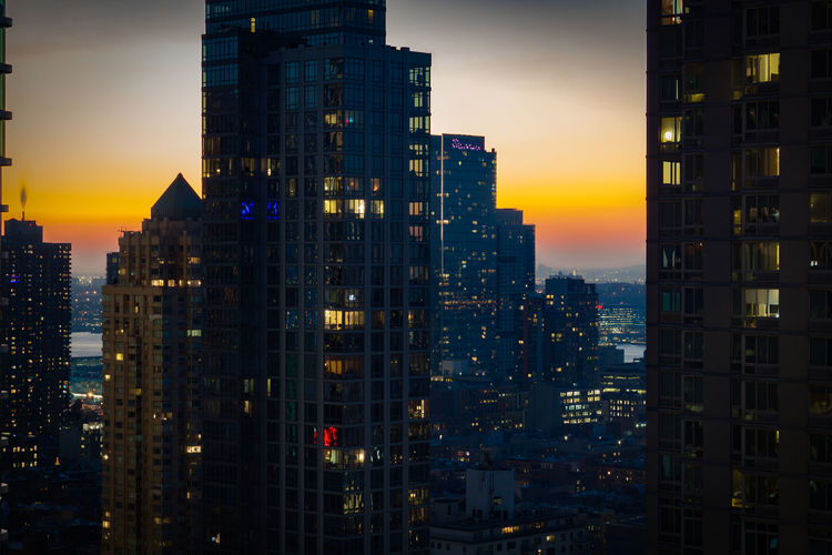 Building Exterior Built Structure Architecture City Building Sky Office Building Exterior No People Sunset Cityscape Skyscraper Illuminated Tall - High Modern Residential District Nature Tower Urban Skyline Orange Color Office Outdoors Apartment