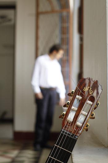 Close-up of guitar indoors