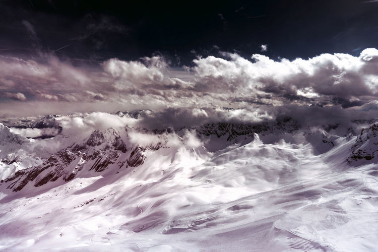 Big snow capped Mountains in front of a dramatic Sky on a sunny Day. Alpine Calmness Sunny Winter Landscape Cloud - Sky Cloudscape Cold Temperature Day Environment Majestic Monochrome Mountain Mountain Range Nature No People Outdoors Scenics - Nature Ski Snow Snowcapped Mountain Tranquil Scene Tranquility White Color Winter 冬の景色