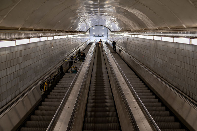 Looking up an escalator from a subway