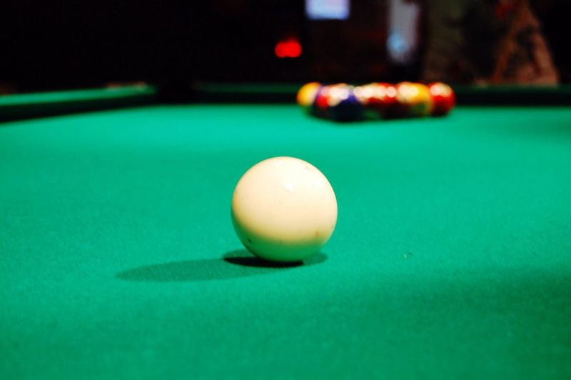Close-Up Of Cue Ball On Pool Table