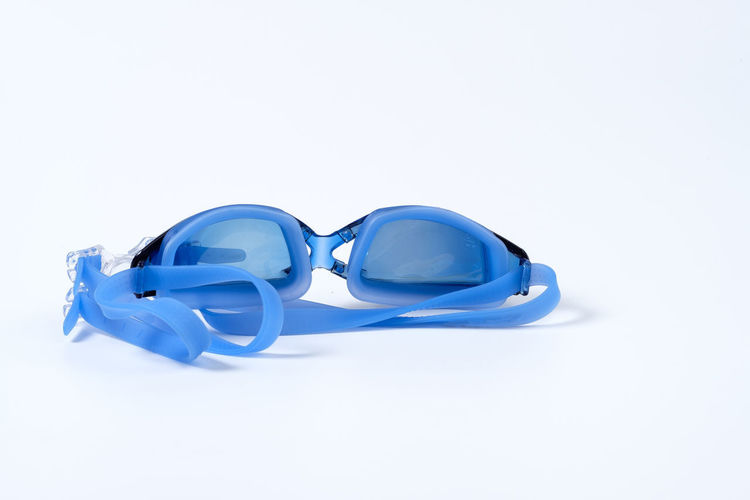 Blue Clean Equipment Glossy Goggle Goggles Rubber Swim Swimming Swimming Goggle White White Background Copy Space Studio Shot Indoors  Still Life Cut Out Close-up No People Glasses Single Object High Angle View Fashion Sunglasses Reflection Plastic Two Objects Security Personal Accessory Protection