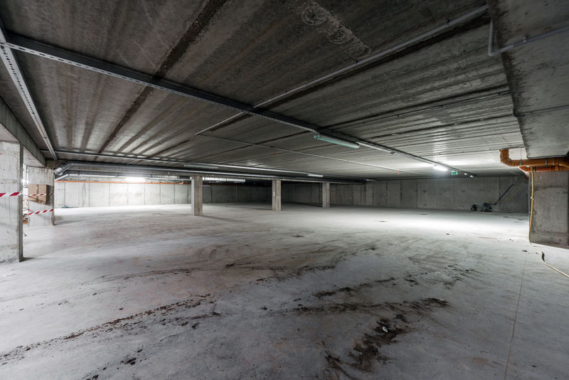 Inside of empty underground parking Underground Built Structure Ceiling Empty Garage Gray Grey Ground Illuminated Indoors  No People Nobody Parking Garage Underground Parking