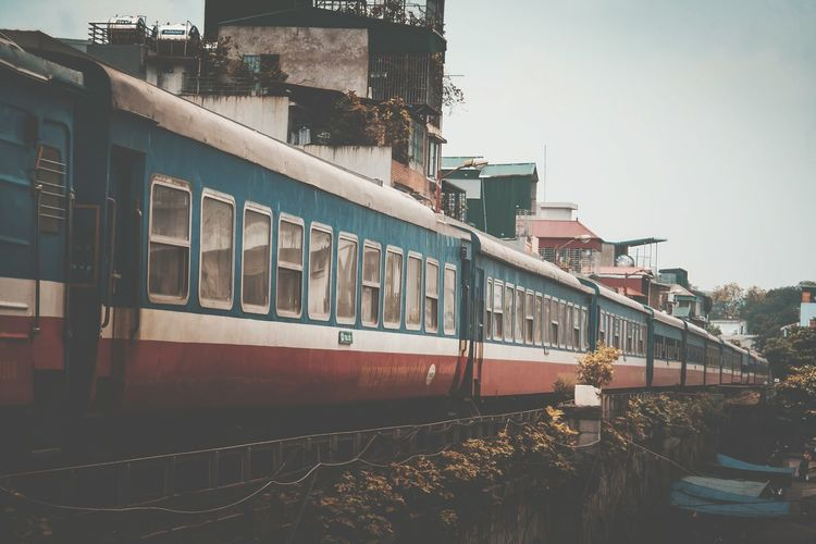 Train by buildings in city