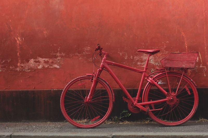 Bicycle City Composition Copyspace Parked Red Red Red Bicycle Red Wall Same Color Scraped Paint Single Color Unusual Urban Wall