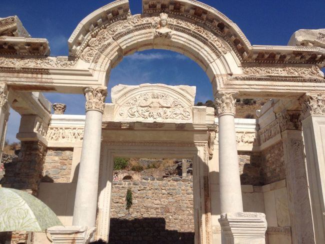 Ephesus - Turkey Architecture Built Structure Low Angle View Carving - Craft Product History Entrance Arch Ornate Famous Place Place Of Worship Façade Outdoors Travel Destinations The Past Sky Tourism Architectural Feature Day Blue