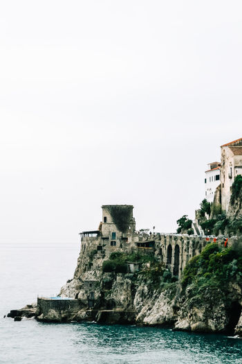 Buildings on rocky coastline  with diminishing perspective