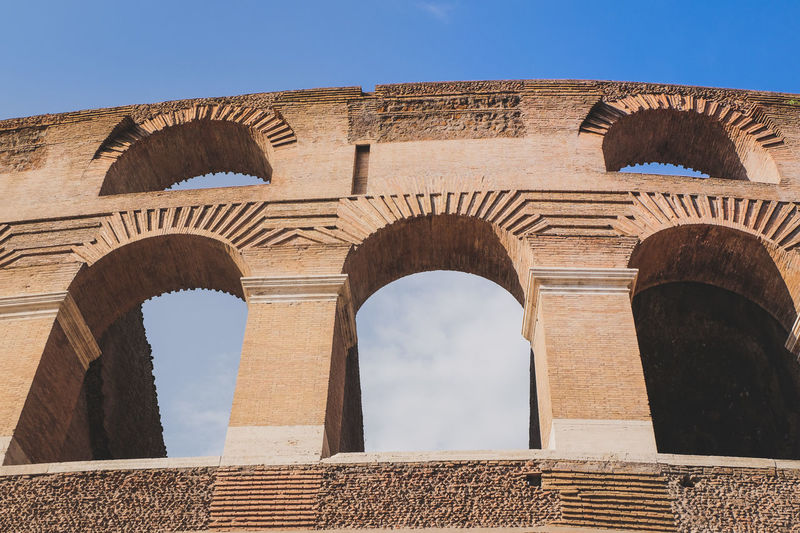 Low angle view of arched structure against sky