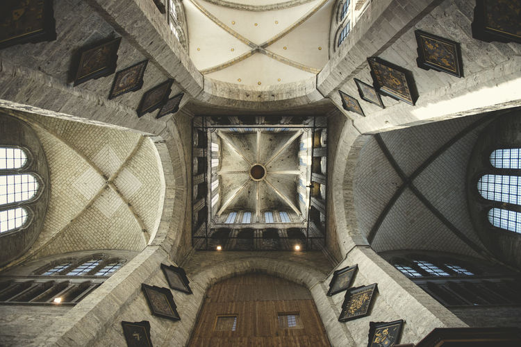 Interior view of the transept of a Gothic style church in a central European city Architecture Architecture And Art Belief Building Built Structure Ceiling Clock Clock Face Day Directly Below History Indoors  Low Angle View No People Ornate Pattern Place Of Worship Religion The Past Time Travel Travel Destinations