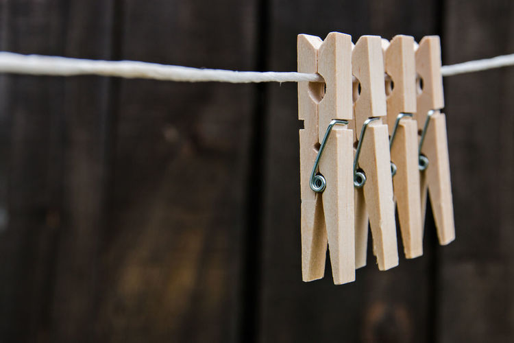 linen clothespins Boundary Close-up Clothesline Clothespin Clothing Day Drying Fence Focus On Foreground Hanging In A Row Metal No People Protection Rope Safety Security Simplicity Still Life Wood - Material