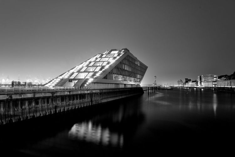 Dockland Hamburg Architecture Built Structure Sky Building Exterior Sea Outdoors No People Travel Destinations Night Cityscape Water City Monochrome Photography Hamburg Dockland cityscape Longtimeexposure Fineart Fineartphotography Travel Hotspots Photography