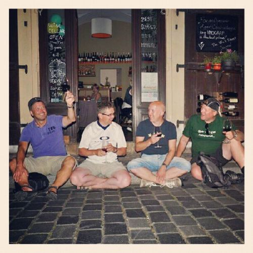 Enjoying a glass of red Wine with my Friends outside the Winebar Vinograf in Prague.