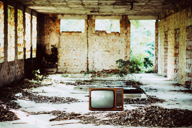 Retro Vintage Television Abandoned Architecture Bad Condition Built Structure Damaged Day Decline Demolished Deterioration Dirt Dirty Indoors  Messy No People Obsolete Old Old Television Ruined Run-down Technology Television Set Vintage Weathered
