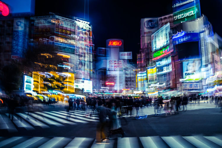 Shibuya Shibuya Crossing Tokyo Japan Neon Futuristic Technology Tech Future Intersection Busy Street Imperfection Nightlife Urban Skyline Urban Blurred Motion Street Photography Urban Landscape Urban Exploration Atmospheric Mood Cyberpunk Cinematic Cinematic Photography Shibuyascapes City Architecture Motion Night Illuminated Building Exterior Street Built Structure Crosswalk Zebra Crossing Crossing City Street City Life Transportation Road Marking Sign Road Crowd Speed Outdoors Modern Humanity Meets Technology My Best Photo
