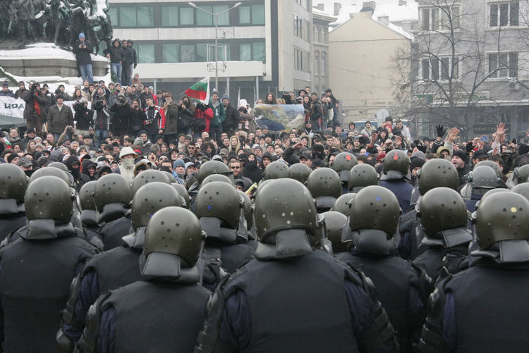 Police brutally beats people who is in blood with heavy wounds on a big protest and rally against government policy in Sоfia, Bulgaria – jan 14, 2010. Policeman Protest Arrest Batons Beat Blood Brutality Constabulary Fight Gandarmerie Gendarmerie Helmet Human Humiliation Nation National National People Police Police Brutality Policemen Rally Regress Victims Victims Of Police Brutality