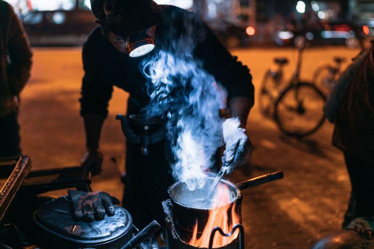 Panoramic view of people preparing food